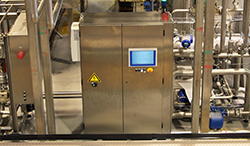 M-Series HMI installed inside machine controller of a bottling facility.
